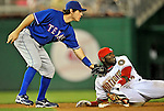 20 June 2008: Washington Nationals' outfielder Elijah Dukes slides safely into second base ahead of the tag by Texas Rangers second baseman Ian Kinsler in the tenth inning at Nationals Park in Washington, DC. Dukes hit a game-tying solo homer in the eighth inning, and the winning RBI in the 14th, leading the Nationals to their 4-3 win over the Rangers in their inter-league matchup...Mandatory Photo Credit: Ed Wolfstein Photo