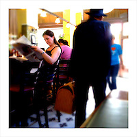 Reading the Sunday newspaper in a San Francisco bar. (iPhone image)