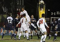 Ethan White #4 of the University of Maryland loses the ball to Brendan Birmingham #28 of Penn State during an NCAA 3rd. round match at Ludwig Field, University of Maryland, College Park, Maryland on November 28 2010.Maryland won 1-0.
