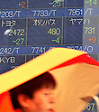 November 11, 2011, Tokyo, Japan - Olympus share is listed on the electric board of a Tokyo stock brokerage during the morning trading Friday, November 11, 2011, the day after its stock was placed on the Tokyo Stock Exchanges  watchlist for possible delisting after the company said it would miss a November 14 deadline to report its quarterly results. Olympus shares have lost around 80 per cent of their value since the scandal broke on October 14 when the company ousted British CEO Michael Woodford, who alleged overpayments in the acquisition deals. (Photo by Natsuki Sakai/AFLO) [3615] -mis-