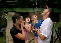 Mick Jones is the local constable of Karumba.  His wife Keriann and his kids, Kacie and Jessica, are delighted at the first rain to hit Karumba... we were ALL waiting.