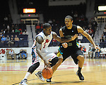 "Ole Miss' Martavious Newby (1) vs. Coastal Carolina's Warren Gillis (0) at the C.M. ""Tad"" Smith Coliseum in Oxford, Miss. on Tuesday, November 13, 2012. (AP Photo/Oxford Eagle, Bruce Newman)"