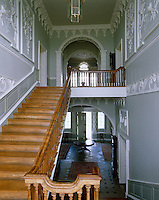 The Staircase Hall at Florence Court resplendent with its decorative woodwork and rococo plasterwork by Robert West