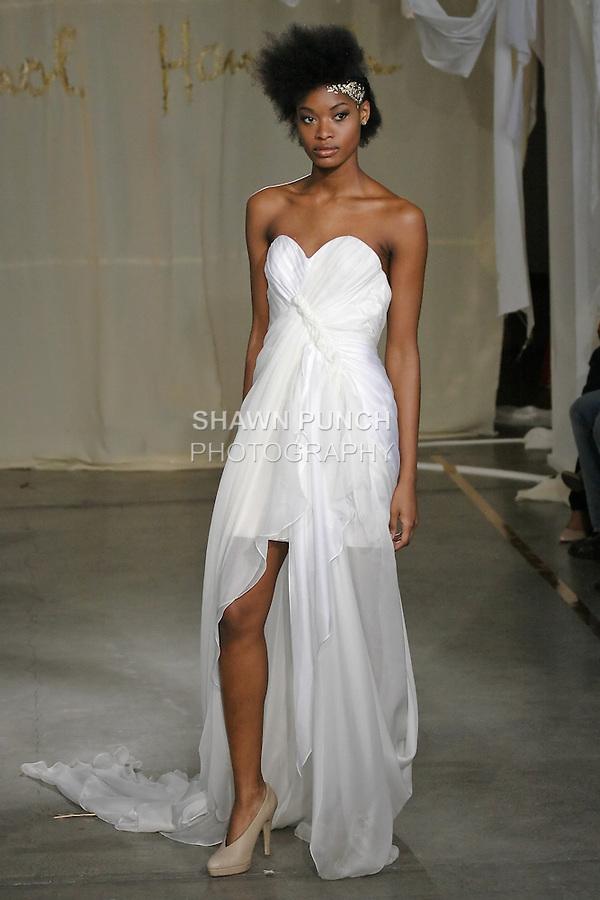 Model walks runway in a Juniper wedding dress by Carol Hannah Whitfield, for the Carol Hannah Spring Summer 2012 Bridal collection runway show.