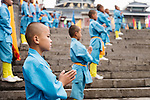 Young Shaolin Kung Fu students on the steps of their school at the opening ceremony of Zhengzhou International Wushu Fetival in DengFeng, Henan, China 2014