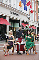 NO REPRO FEE. 4/8/2011. A Taste of Carton House in Brown Thomas Dublin.Browns Bar and Café by Carton House opens in Ireland's Premier Department Store. Models Teo Sutra and Angelica Salomao with waiter Francesco were pictured today ( August 4th 2011) indulging in Afternoon Tea with a stylish twist outside Brown Thomas Dublin on Grafton Street as Carton House, one of Ireland's most luxurious hotels, officially opened the doors of the most fashionable café in the heart of Dublin - Browns Bar & Café by Carton House which is housed within the iconic department store. Picture James Horan/Collins Photos