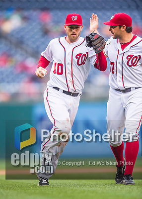 28 April 2016: Washington Nationals third baseman Stephen Drew returns to the dugout, with a pat from Tanner Roark, after getting the third out in the 5th inning against the Philadelphia Phillies at Nationals Park in Washington, DC. The Phillies shut out the Nationals 3-0 to sweep their mid-week, 3-game series. Mandatory Credit: Ed Wolfstein Photo *** RAW (NEF) Image File Available ***
