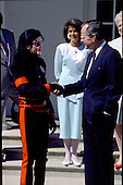 Michael Jackson and United States President George H.W. Bush shake hands after speaking to reporters in the Rose Garden at the White House in Washington, DC on April 5, 1990..Credit: Ron Sachs / CNP