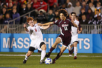 Ohio State Buckeyes defender Matt Gold (6) and University of Massachusetts Minutemen forward Bryan Hogan (11) battle for the ball during an NCAA College Cup semi-final match at SAS Stadium in Cary, NC on December 14, 2007. Ohio State defeated Massachusetts 1-0.