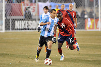 Javier Mascherano (14) of Argentina is trailed by Jozy Altidore (17) of the United States. The United States (USA) and Argentina (ARG) played to a 1-1 tie during an international friendly at the New Meadowlands Stadium in East Rutherford, NJ, on March 26, 2011.