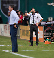 D.C. United  head coach Ben Olsen reacts to a referee's call during a Major League Soccer game at RFK Stadium in Washington, DC.  New England defeated D.C. United, 2-1.