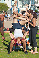 Acrobats workout at Muscle Beach on Sunday, June 23, 2012.