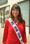 Merrick, New York, USA. 13th September 2014. JANE RUBINSTEIN of Merrick, Ms. New York Senior America 2014, wears a tiara, and a sash over her red evening gown at the 23rd Annual Merrick Fall Festival & Street Fair in suburban Long Island.
