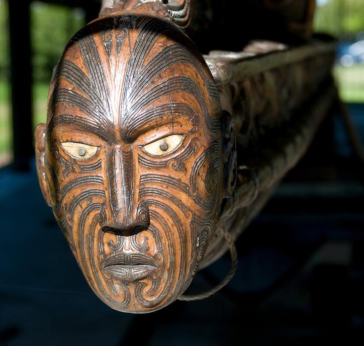 Carved Maori head on prow of a Waka canoe, Rotorua.