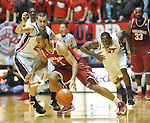 "Arkansas' Rickey Scott (3) is defended by Mississippi's Marshall Henderson (22) at the C.M. ""Tad"" Smith Coliseum in Oxford, Miss. on Saturday, January 19, 2013. Mississippi won 76-64. (AP Photo/Oxford Eagle, Bruce Newman)"