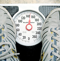 APPROXIMATE MEASUREMENT. Person Being Weighed On Scale, Reading 147.7lbs. A traditional scale does not read tenths of a pound, the reading of 147.7lb must be estimated.