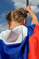 Moscow, Russia, 11/06/2007..A young woman wrapped in a Russian flag at the latest anti Putin demonstration. Some two thousand opposition demonstrators gathered in central Moscow under the banner of the Other Russia movement led by Garry Kasparov and Eduard Limonov, leader of the banned National Bolshevik Party. A planned march was banned, and the demonstrators held a meeting in a central square instead..