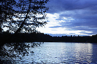 Hortonia, VT, USA - August 22, 2011: View across a lake as clouds from a distant Hurricane Irene approach mid Vermont.