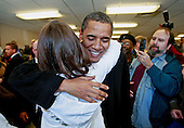 Chicago, Il - November 21, 2008 -- United States President-elect Barack Obama hugs a customer at Manny's Coffee Shop and Deli during a lunch break from his transition office at the federal building, Friday, November 21, 2008 in Chicago, Illinois. Obama ordered a corned beef sandwich and greeted customers before leaving the restaurant. .Credit: Scott Olson - Pool via CNP