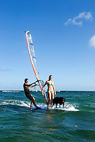 Couple &amp; dog windsurfing together, Oahu, Hawaii.   Early 30's, caucasian.