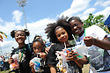 New Orleans school childrenTaheya Williams, Terrian Tidwell, Shanaza Massey and Jasmine Cain take a day off to eat snowballs and enjoy the great weather at the New Orleans Jazz and Heritage Festival, Thursday, April 29, 2010.<br /> <br /> (AP Photo/Cheryl Gerber)