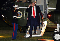 United States President Donald Trump salutes a US Marine as he disembarks from Marine One on his return to the White House from a long weekend at his Mar-a-Lago estate in Florida, on President's Day, February 20, 2017, Washington, DC.       <br /> Credit: Mike Theiler / Pool via CNP /mediaPunch