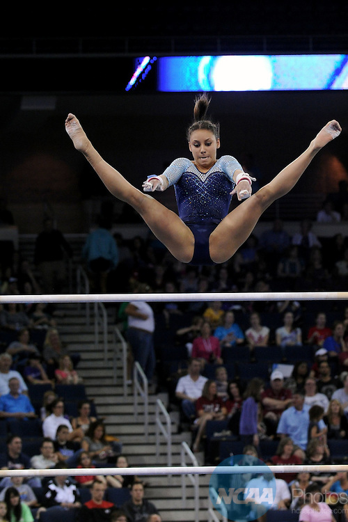 21 APR 2012:  Mattie Larson of UCLA performs on the uneven bars during the Division I Women's Gymnastics Championship held at the Gwinnett Center Arena in Duluth, GA. Joshua Duplechian/NCAA Photos