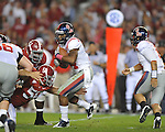 Ole Miss running back Brandon Bolden (34) is tackled by Alabama defensive lineman Nick Gentry (58)at Bryant-Denny Stadium in Tuscaloosa, Ala.  on Saturday, October 16, 2010. Alabama won 23-10.
