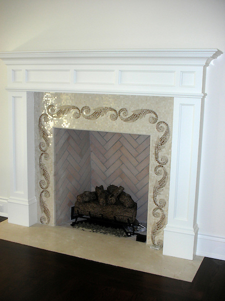 Caesar Scroll fireplace surround in brown and cream polished marble.