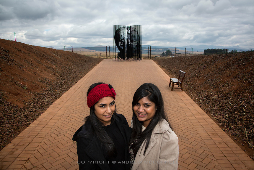 Sisters Maschka Rampersad, 21, and Ruvunya Rampersad, 23, both from Durban, pictured at the Nelson Mandela memorial in Howick, South Africa. It was here on 5 August 1962 that Nelson Mandela was captured by the police.