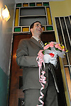 Taiwanese Wedding -- Groom walking up to the top floor of the bridal home, where the couple prays for blessings of the bride's ancestors in front of the family shrine.