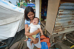 A child yawns on Jinamoc Island, part of the municipality of Basey in the Philippines province of Samar that was hit hard by Typhoon Haiyan in November 2013. The storm was known locally as Yolanda, and left most of the island's boats, nets, and houses destroyed. The ACT Alliance has been providing a variety of assistance to survivors here, and is planning a long-term rehabilitation program with residents.