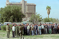 Iraqi men undergo military basic training by the Al Shawy mosque, in preparation for a feared attack. The crisis over weapons inspections brought the Gulf to the brink of war, but U.N. Secretary-General Kofi Annan and Iraq signed a deal in 1998, which turned out to postpone the conflict.   In the background, the Al-Mansour hotel, used by many journalists.