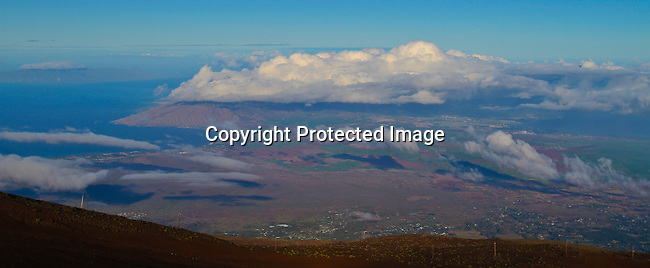 The view of Maui from atop 10,023 foot Haleakala Volcano Crater in the middle of the Pacific Ocean in Haleakala National Park on the Island of Maui, Hawaii. - Photo by Jim Urquhart/Straylighteffect.com<br /> 11/17/2009