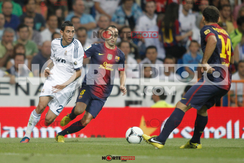 Real Madrid's  Di Maria and Barcelona's Iniesta during Super Copa of Spain on Agost 29th 2012...Photo:  (ALTERPHOTOS/Ricky) Super Cup match. August 29, 2012. <br />