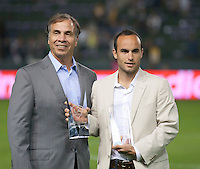 CARSON, CA - October 16, 2011: LA Galaxy head coach Bruce Arena presents midfielder Landon Donovan with the Galaxy's Most Valuable Player and Golden Boot Awards before the match between LA Galaxy and Chivas USA at the Home Depot Center in Carson, California. Final score LA Galaxy 1, Chivas USA 0.