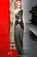 Josephine walks runway in an ebony Sunburst embroidered one-shoulder silk crepe and tulle gown, from the Reem Acra Fall 2012 Feminine Power collection fashion show, during Mercedes-Benz Fashion Week New York Fall 2012 at Lincoln Center.