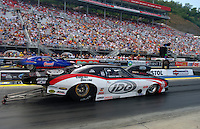 Jun. 17, 2011; Bristol, TN, USA: NHRA pro mod driver Rickie Smith (near lane) alongside Kenny Lang during qualifying for the Thunder Valley Nationals at Bristol Dragway. Mandatory Credit: Mark J. Rebilas-