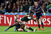 Lwazi Mvovo of South Africa looks to reach the USA try-line. Rugby World Cup Pool B match between South Africa and the USA on October 7, 2015 at The Stadium, Queen Elizabeth Olympic Park in London, England. Photo by: Patrick Khachfe / Onside Images
