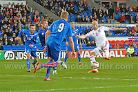James Collins of Wales scorer of the 1st Wales goal attempts a shot at goal. Cardiff City Stadium, Cardiff, Wales, Wednesday 5th March 2014. The Football Association of Wales - Vauxhall International Friendly - Wales v Iceland. Pictures by Jeff Thomas Photography - www.jaypics.photoshelter.com - Contact: thomastwotimes@live.co.uk - 07837 386244