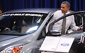 United States President Barack Obama looks at Ford 2013 C-Max Energi during a visit to the DC Auto Show at the Walter E. Washington Convention Center in Washington, DC on January 31, 2012. .Credit: Olivier Douliery / Pool via CNP..