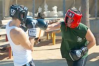 Boxers exchange blows at Santa Monica Chess Park while filming a video on Saturday, August 18, 2012.