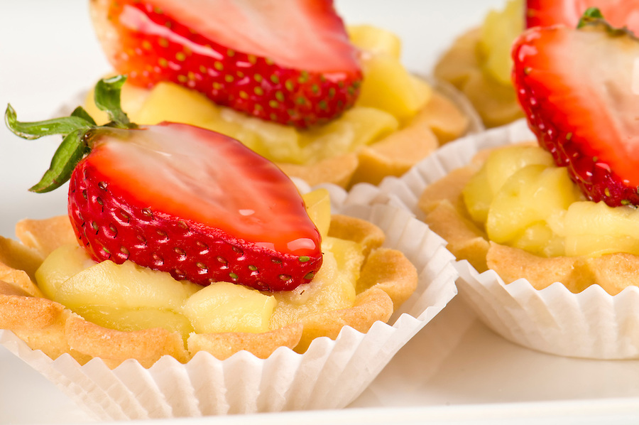 Homemade dessert of strawberry and cream in tray.