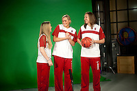 INDIANAPOLIS, IN - APRIL 1, 2011: Kayla Pedersen, Joslyn Tinkle and Lindy La Rocque prepare for an on camera taping at Conseco Fieldhouse during the NCAA Final Four in Indianapolis, IN on April 1, 2011.