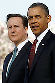 U.S. President Barack Obama (R) welcomes British Prime Minister David Cameron during an official arrival ceremony at the South Lawn of the White House March 14, 2012 in Washington, DC. Prime Minister Cameron is on a three-day visit to the U.S. and he is expected to have talks with Obama on the situations in Afghanistan, Syria and Iran.  .Credit: Chip Somodevilla / Pool via CNP