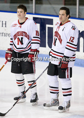 Wade MacLeod (Northeastern - 19), Dennis McCauley (Northeastern - 12) - The Northeastern University Huskies defeated the Boston College Eagles 2-1 OT in the NU senior night game on Friday, March 6, 2009 at Matthews Arena in Boston, Massachusetts.