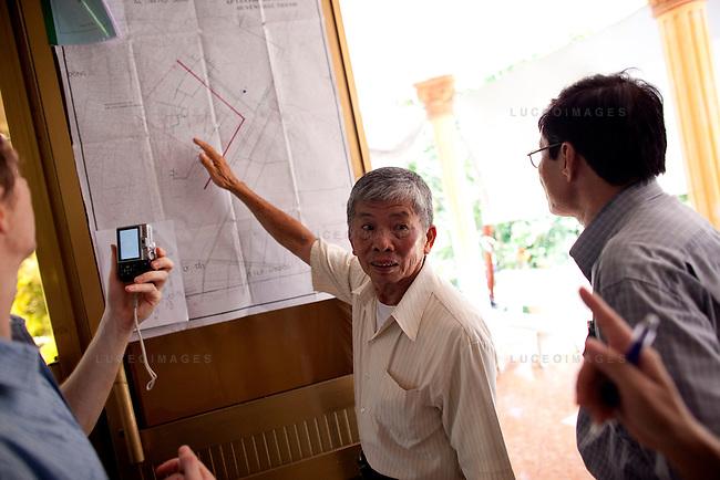 Pham Van Thang, 72, back left, owner of the Tan Huong enterprise.