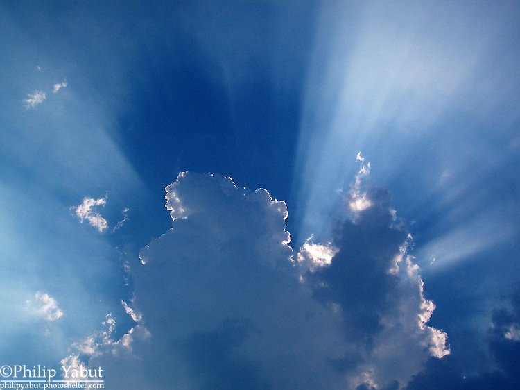 Crepuscular rays and cloud shadows.