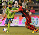 Seattle Sounders Clint Dempsey (2) controls the ball against Portland Timbers Jack Jewsbury (13) during an MLS match on April 26, 2015 at CenturyLink Field in Seattle, Washington.  Seattle Sounders Clint Dempsey scored a goal to give the Sounders a 1-0 victory over the Timbers. Jim Bryant Photo. ©2015. All Rights Reserved.