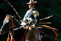 Nov 3, 2009- Tokyo, Japan- A Yabusame rider  from Takedaryu rides past spectators at horse-back archery event at Meiji shrine during celebrations for Culture Day...